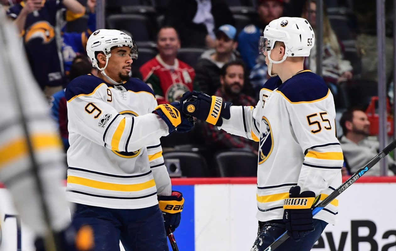 Rasmus Ristolainen, right,  gives it up to Evander Kane after the Sabres winger scored the tiebreaking goal Tuesday in Colorado (USA Today Sports).