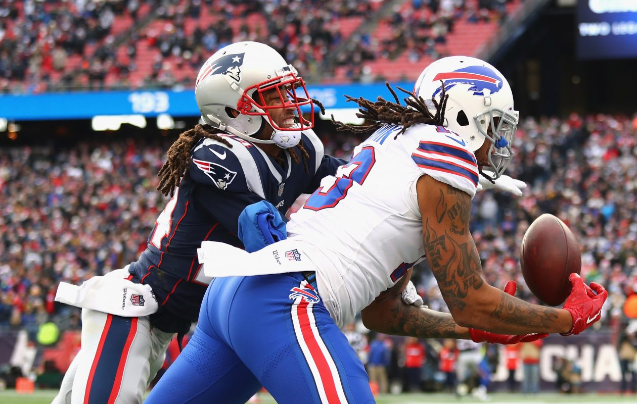 Kelvin Benjamin of the Buffalo Bills catches a touchdown pass as he is defended by Stephon Gilmore of the New England Patriots during the second quarter of a game at Gillette Stadium on Dec. 24, 2017, in Foxboro, Mass. The touchdown was reversed after a review.  (Tim Bradbury/Getty Images)