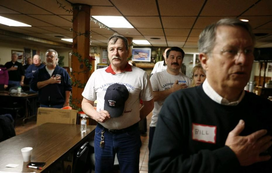 Greg Furlong, center-left, and members of the Leatherstocking Honor Flight group recite the Pledge of Allegiance at the beginning of an organizing session for volunteers at the George F. Lamm American Legion Post in Amherst on Saturday, April 9, 2016. (Derek Gee/Buffalo News)