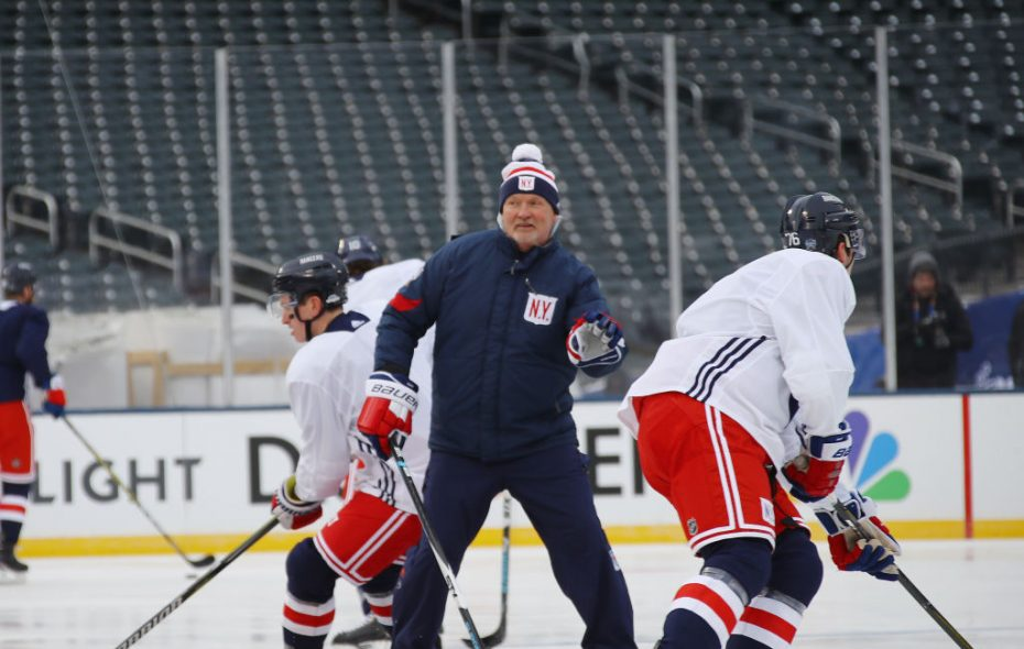 A bundled-up Lindy Ruff works a drill with the New York Rangers Sunday in Citi Field (Getty Images).