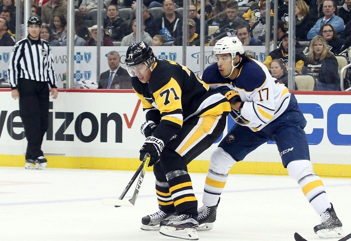 Evgeni Malkin works against Jordan Nolan of the Sabres (USA Today Sports).