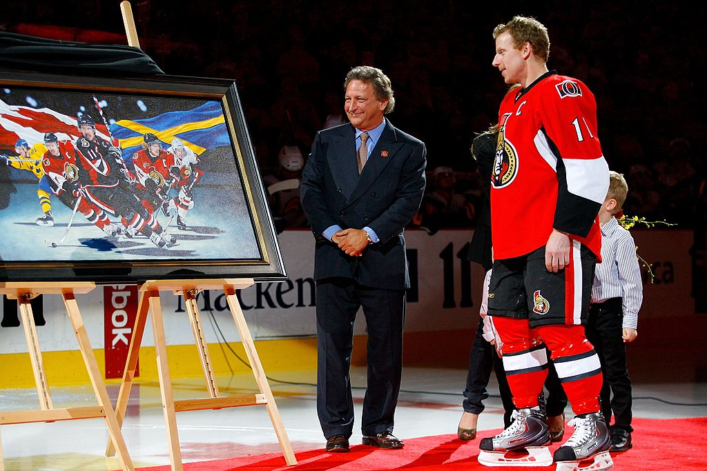 Senators owner Eugene Melnyk, shown honoring former captain  Daniel Alfredsson in 2010, has been a lightning rod for criticism in Ottawa (Getty Images).