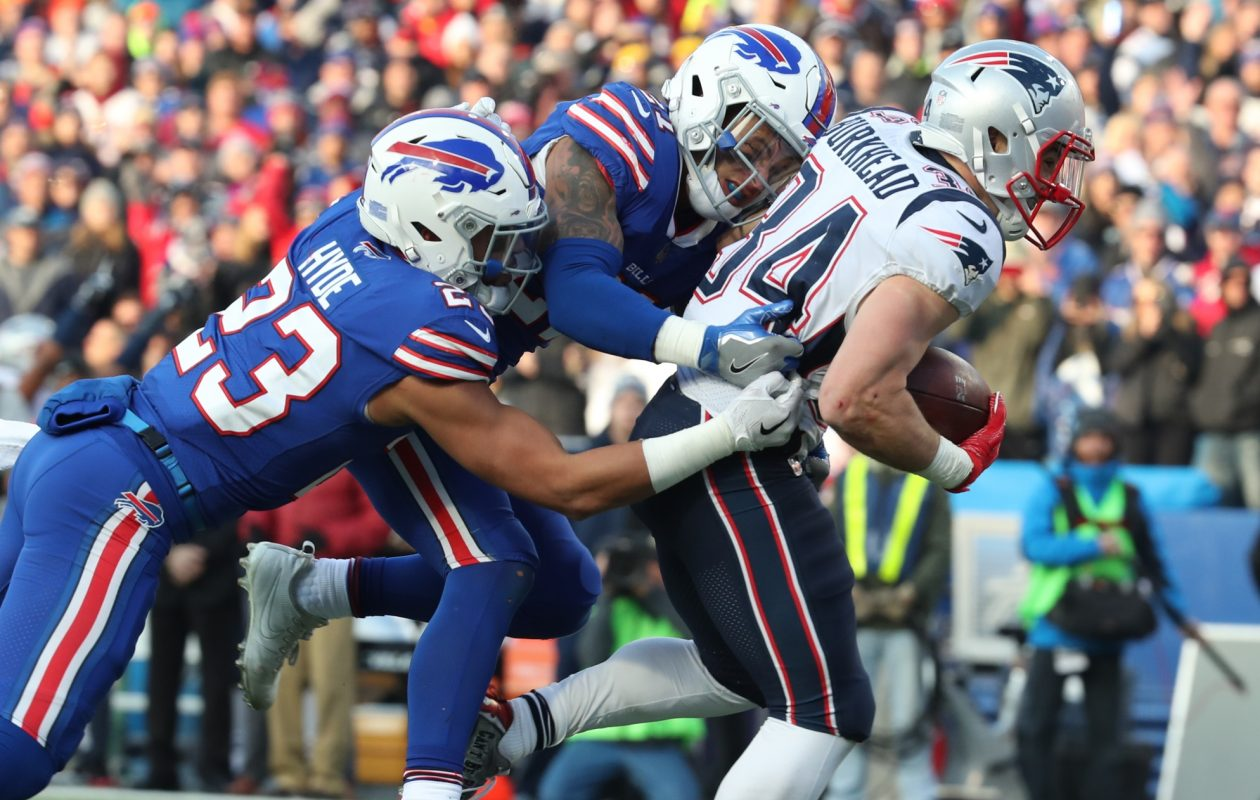 New England Patriots running back Rex Burkhead (34) rushes for a first down against Buffalo Bills strong safety Micah Hyde (23) in the third quarter at New Era Field on Sunday, Dec. 3, 2017.  (James P. McCoy / Buffalo News)