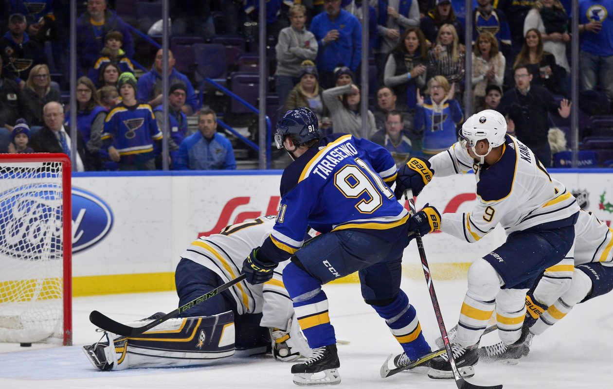 St. Louis' Vladimir Tarasenko beats Evander Kane and Jack Eichel to the net and Robin Lehner on the pokecheck to score the OT goal that beat the Sabres (USA Today Sports).