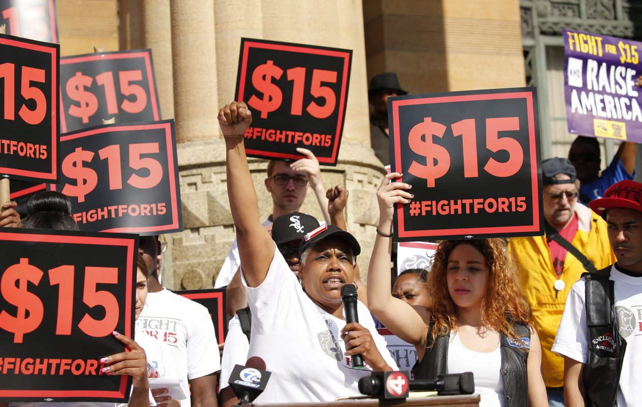 Charmaine Rookard, who works at KFC, speaks during a rally outside Buffalo City Hall to call for a $15/hour minimum wage before a hearing of the governor's wage board in 2015.  (Derek Gee/Buffalo News file photo)