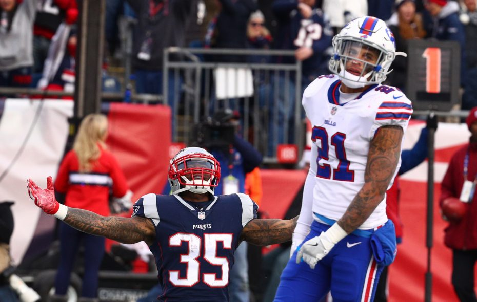 New England Patriots running back Mike Gillislee (35) celebrates a touchdown in front of Buffalo Bills free safety Jordan Poyer (21) in the third quarter.  (James P. McCoy / Buffalo News)