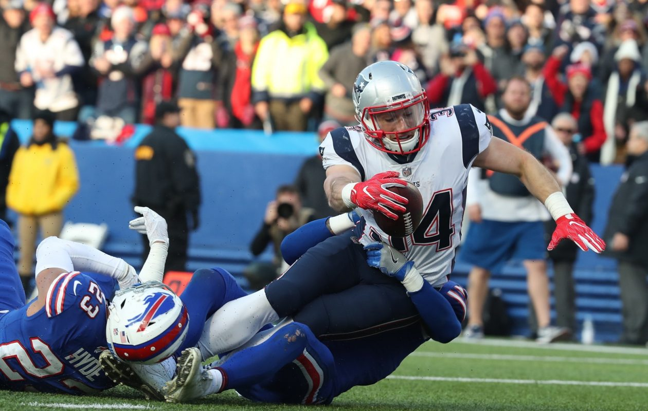 New England Patriots running back Rex Burkhead (34) stretaches for extra yardage Sunday against Buffalo Bills strong safety Micah Hyde. (James P. McCoy / Buffalo News)