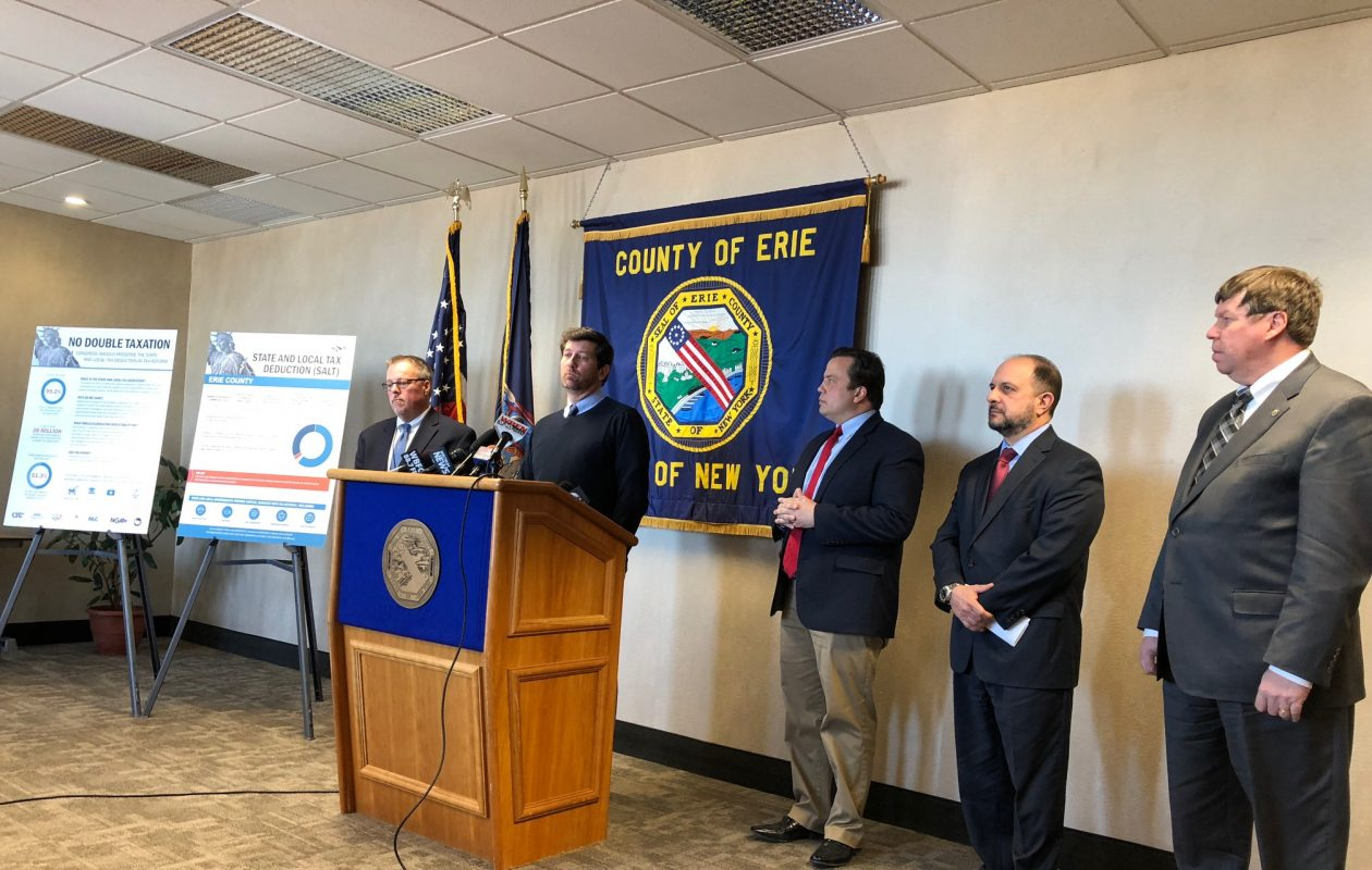 Erie County Executive Mark Poloncarz, County Comptroller Stefan Mychajliw and other county officials talk about prepaying local property taxes at a news conference on Wednesday, Dec. 27, 2017. (Stephen T. Watson/Buffalo News)