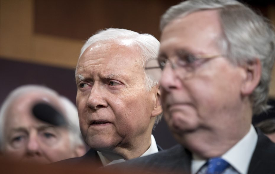 Sen. Orrin Hatch, R-Utah, is flanked by Sen. John Cornyn, R-Texas, left, and Senate Majority Leader Mitch McConnell, R-Ky., at a Capitol Hill news conference after passage of the Republican tax plan early Wednesday, Dec. 20, 2017. Republicans took a critical step toward notching their first significant legislative victory since assuming full political control, as the House and Senate voted along party lines on Tuesday and into early Wednesday to pass the most sweeping rewrite of the tax code in decades. (Tom Brenner/New York Times)