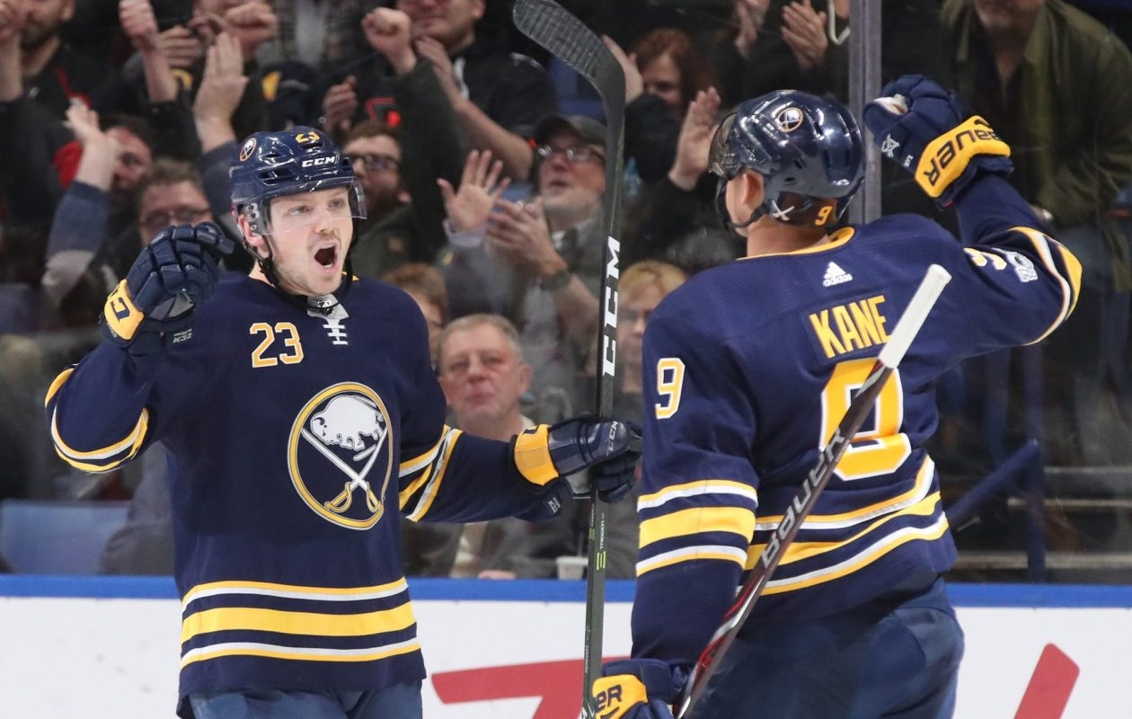 Sam Reinhart, left, gives it up to Evander Kane after Kane gave the Sabres a 3-0 lead in the second period (James P. McCoy/Buffalo News).