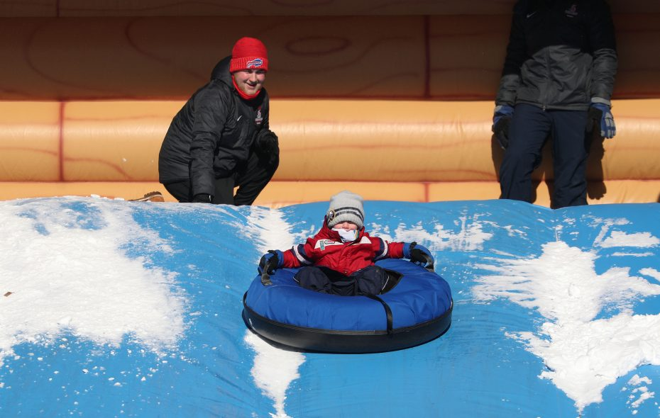 Jackson Turner, 6, of Grand Island, goes down Snowzilla, a free ride at  Championship Village at Canalside on  Tuesday, Dec. 26, 2017. (Sharon Cantillon/Buffalo News)