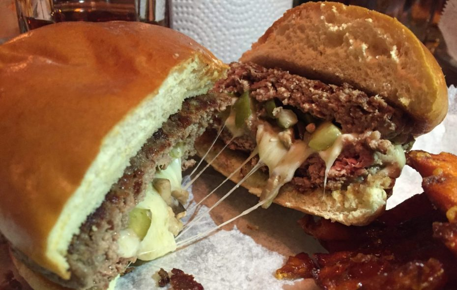 """The molten cheese core of a Swiss cheese, mushroom, and pickle """"Stooge"""" at Stooges Stuffed Burger Bar in Lockport (Phil Wagner/Special to The News)"""