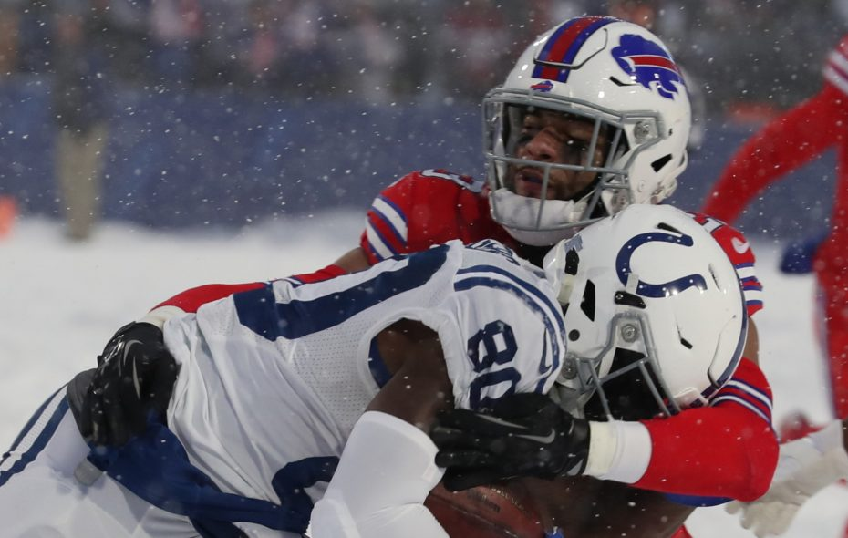 Buffalo Bills strong safety Micah Hyde (23) tackles Indianapolis Colts wide receiver Chester Rogers (80) in overtime on Sunday, Dec. 10, 2017. (James P. McCoy/Buffalo News)