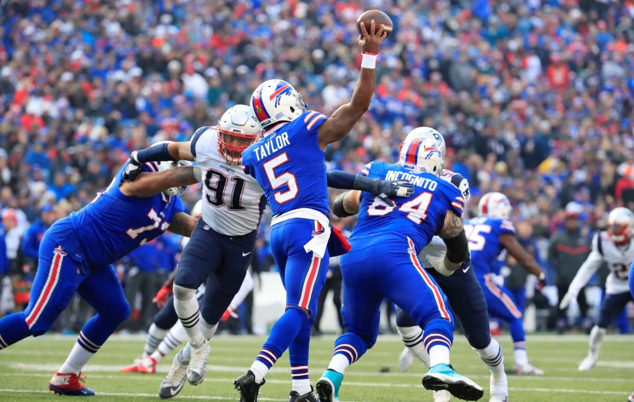 Buffalo Bills quarterback Tyrod Taylor is pressured by New England's Deatrich Wise Jr. during third quarter action at New Era Field on Dec. 3, 2017. (Harry Scull Jr./ Buffalo News)