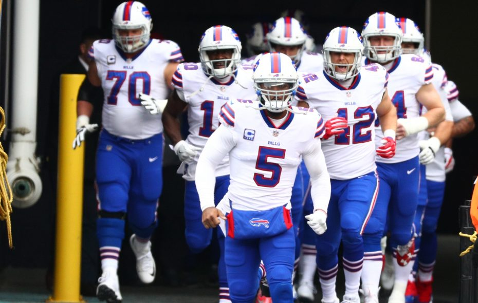 Buffalo Bills quarterback Tyrod Taylor (5) leads the team out to the field at Gillette Stadium in Foxborough, Mass., on Sunday, Dec. 24, 2017.  (James P. McCoy/Buffalo News)