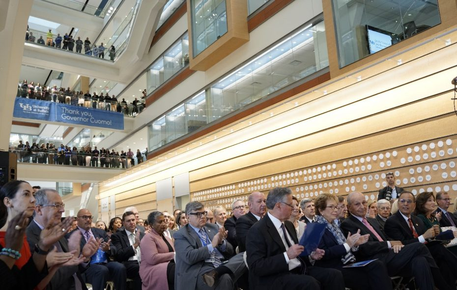 The audience fills the floor of the atrium in the center of the new UB Jacobs School of Medicine and Biomedical Sciences for the building's grand opening Tuesday. (Derek Gee/Buffalo News)