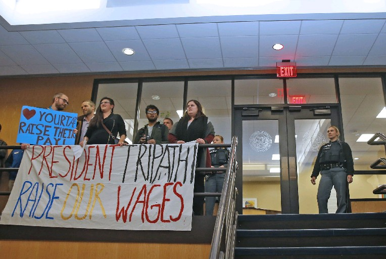 Members of the UB Living Stipend Movement brought their protest and rally to UB President Satish Tripathi's office demanding higher stipends to help them meet their costs. (Robert Kirkham/Buffalo News)