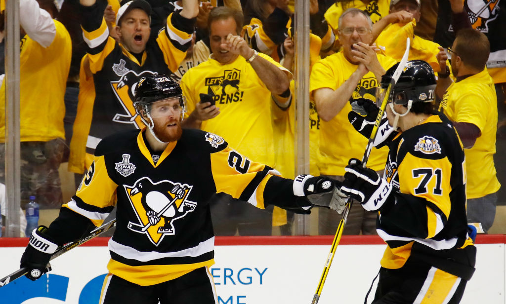 Scott Wilson, left, celebrates his goal for the Penguins with Evgeni Malkin during Game Two of the Stanley Cup final in June. (Getty Images)