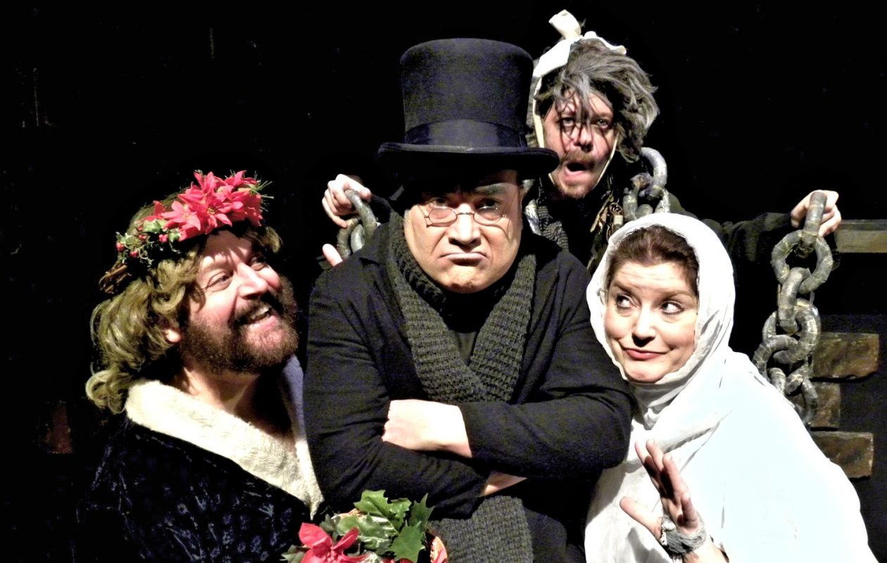 Alleyway Theatre's long-running production of a Christmas Carol features, from left, Roger VanDette, David Mitchell, David Poole and Joyce Stilson.