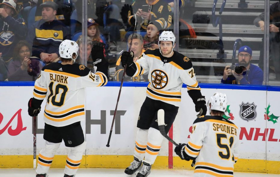 Boston's Jake DeBrusk, middle, celebrates his goal Tuesday night with Anders Bjork (10) and Ryan Spooner. (Harry Scull Jr./Buffalo News)