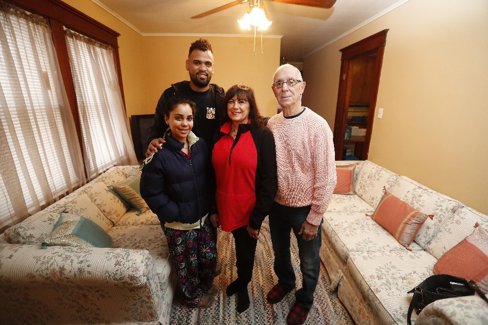 Elizabeth Marie Olivencia, who fled Hurricane Maria in Puerto Rico, with her husband, Francisco, and Joe and Toni Marie Di Leo. The Di Leos, through the Per Niente organization, have helped the family recover from the storm. (Mark Mulville/Buffalo News)