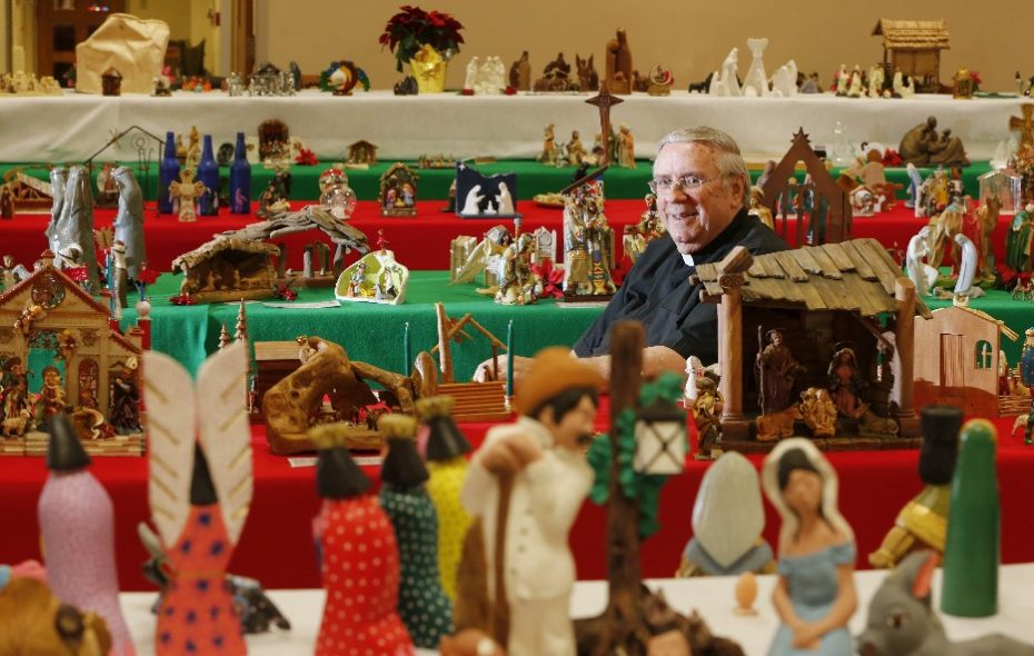 The Rev. Roy Herberger with his collection of nativity sets at SS. Columba-Brigid Church in Buffalo. (Derek Gee/Buffalo News)
