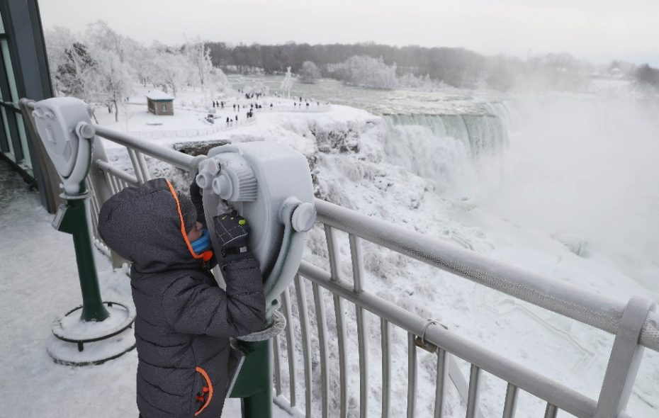 "Niagara Falls made international news earlier this month when ice crusted over the cataracts because of the extreme cold, giving it a ""frozen appearance."" (Sharon Cantillon/Buffalo News)"
