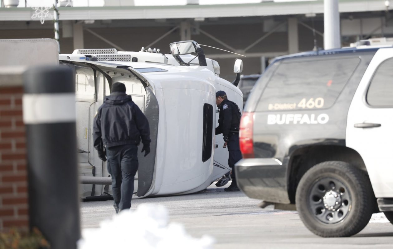 The scene on the Peace Bridge Saturday morning where a tractor-trailer rolled over. (Derek Gee/Buffalo News)