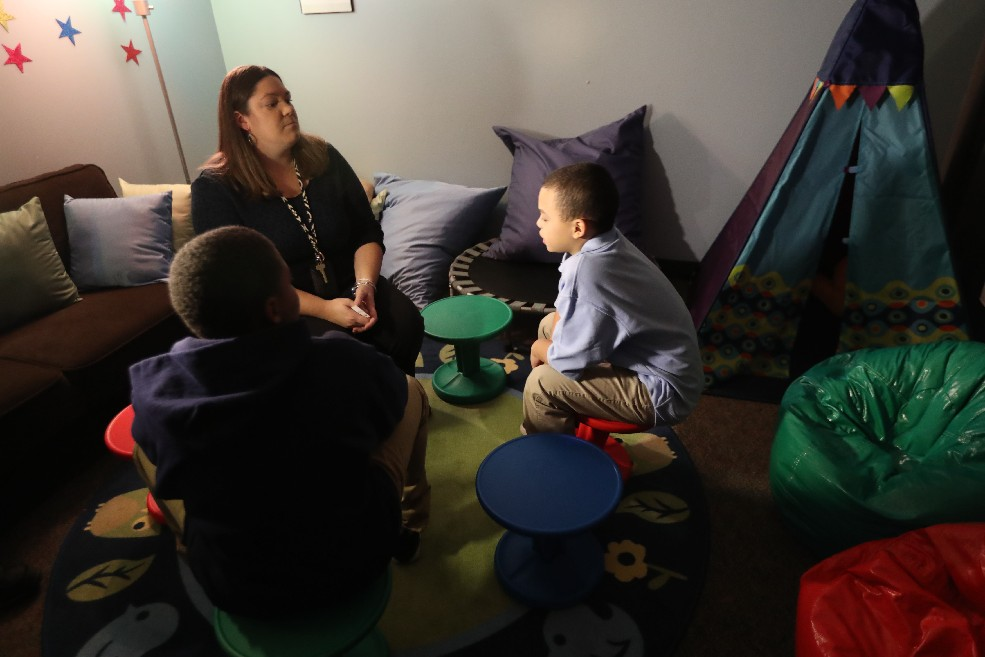 School social worker Jessica Scholze uses a 'restorative' conferencing circle with fourth graders Diego Taite, left and Zaidiel Osoreo, at George E. Blackman School of Excellence. The district's use of such options has reduced suspensions, but has teachers complaining that bad behavior is going unpunished. (Sharon Cantillon/Buffalo News file photo)