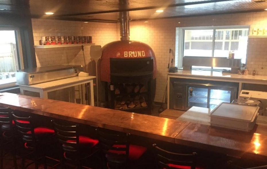 Customers at the new copper-topped pizza bar can watch pizzaiolos in action. (Sonny Red's)