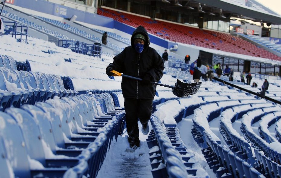 Shovelers clear the seats of snow using in the lower bowl of New Era Field in Orchard Park Friday, December 8, 2017. Crews were getting ready for this SundayþÄôs game with the Colts. (Mark Mulville/Buffalo News)