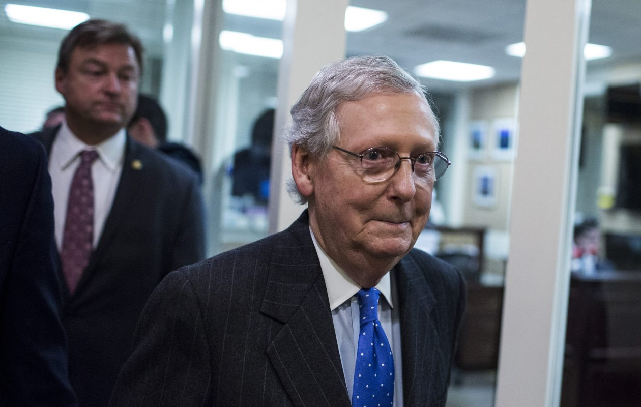 Senate Majority Leader Mitch McConnell, R-Ky., leaves a news conference after voting on the Tax Cuts and Jobs Act in the U.S. Capitol in Washington on Dec. 20, 2017. (Bloomberg photo by Zach Gibson)