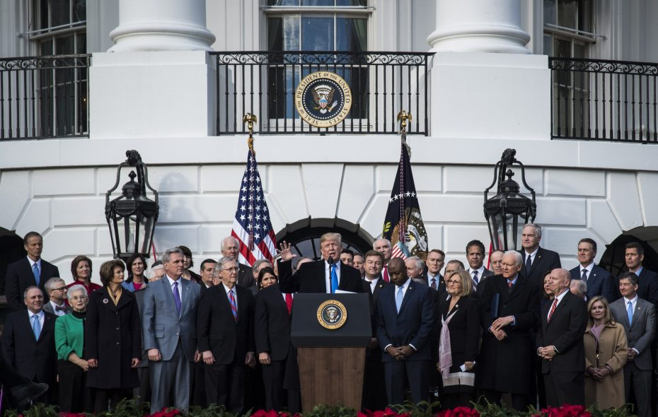 President Donald Trump and congressional Republicans celebrate passage of their tax bill at the White House on Wednesday. (Washington Post photo by Jabin Botsford)