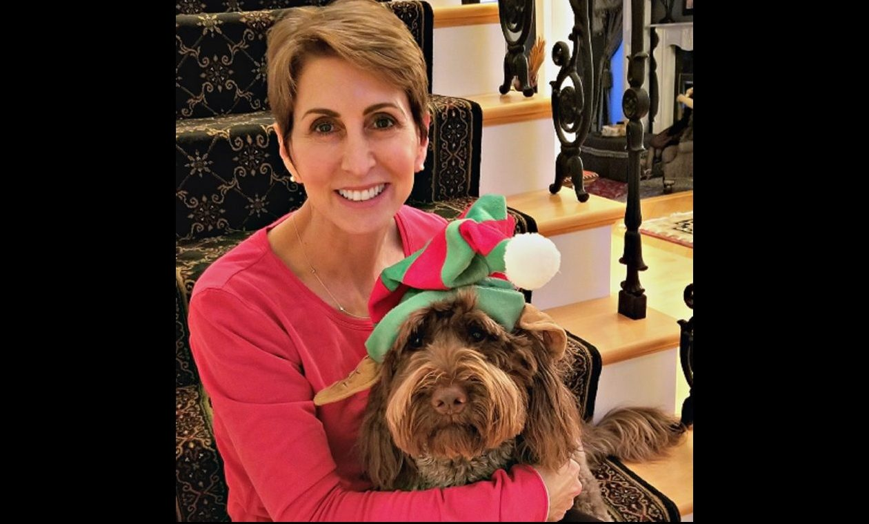 Michelle Sharf, of Amherst, says her therapy dog, Murphy, thinks he's a lap dog.