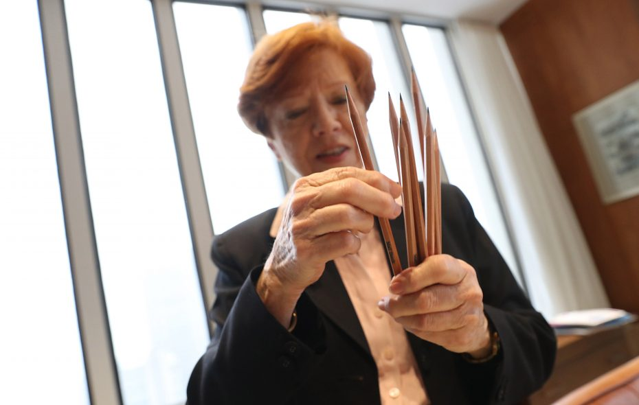 Gerri Kozlowski, Robert Wilmers' executive assistant for almost 12 years, with the eight sharpened pencils he always used at his desk. (Sharon Cantillon/Buffalo News)