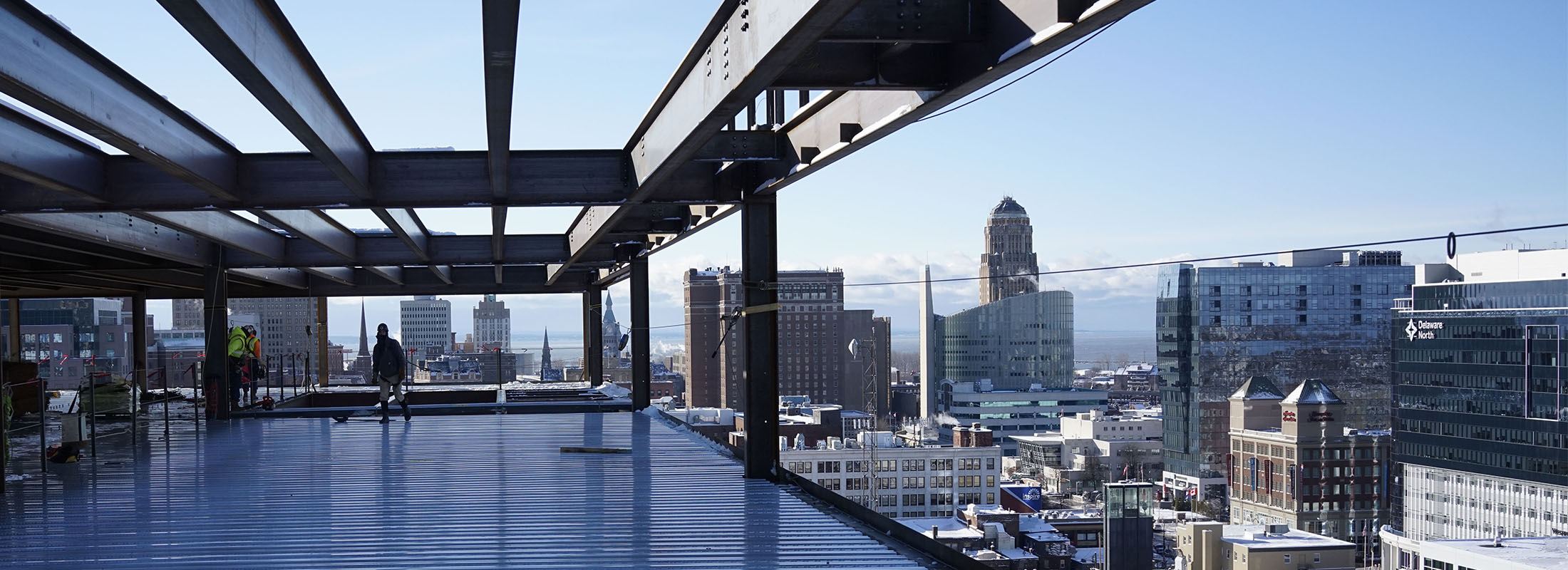 Ironworkers install the steel decking on the 12th floor of 500 Pearl St. (Derek Gee/Buffalo News)