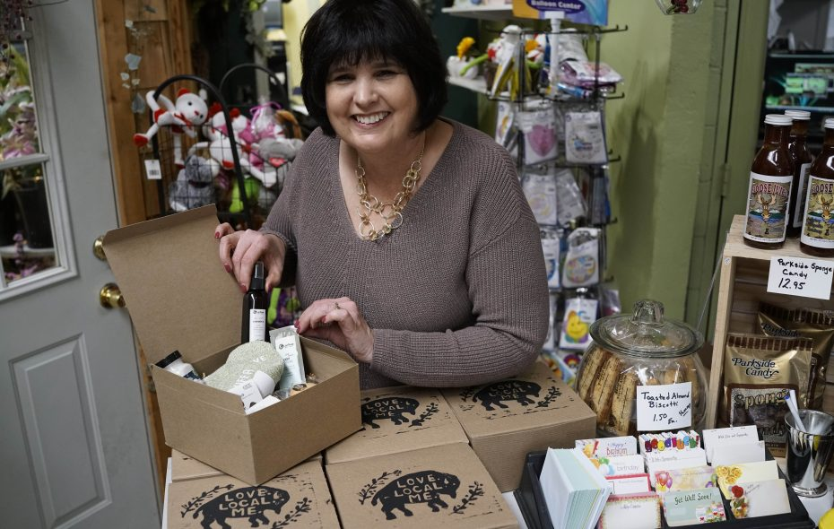 Julie Hallgren arranges Love. Local. Me. gift boxes that feature a variety of locally sourced items. (Derek Gee/Buffalo News)