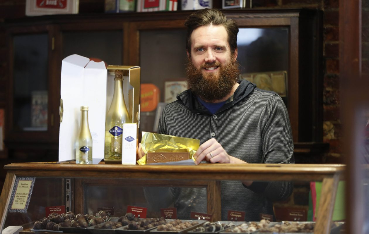 Choco-Logo owner Bob Little holds the chocolate bar the company has made to pair with Blue Nun sparkling wine to be given as gifts to people attending Sunday's Golden Globe Awards. (Mark Mulville/Buffalo News)