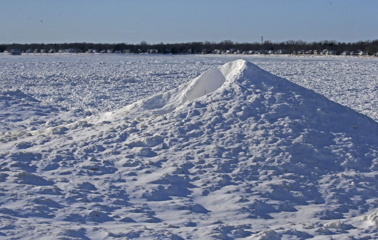 The frigid weather has made some unusual ice and snow formations along the Ontario, CA shoreline like this 'ice volcanoe' near Crystal Beach on Friday, Jan. 5, 2018.  (Robert Kirkham/Buffalo News)