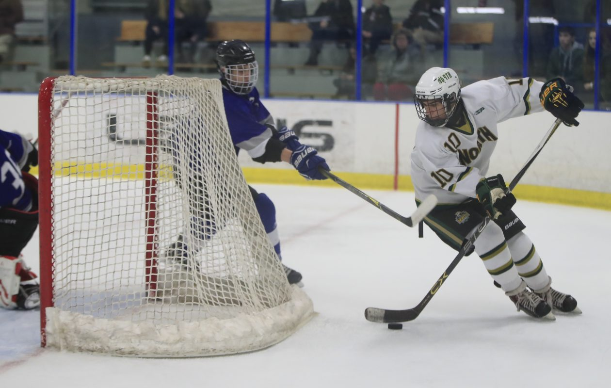 Williamsville North's Andrew Bruno skates behind the Frontier net during a 12-0 Spartans win at the Northtown Center on Saturday. (Harry Scull Jr./Buffalo News)