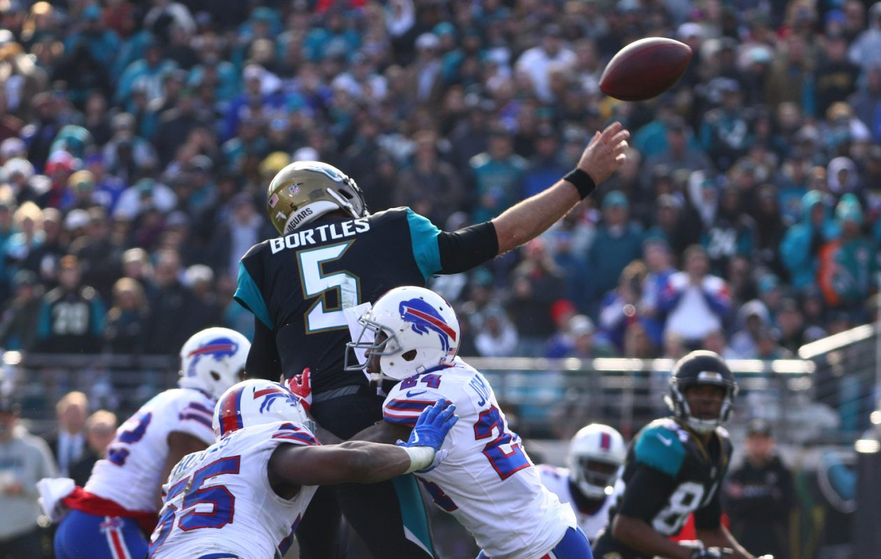 Bills defensive back Leonard Johnson (24) pressures Jacksonville quarterback Blake Bortles. (James P. McCoy/News file photo)