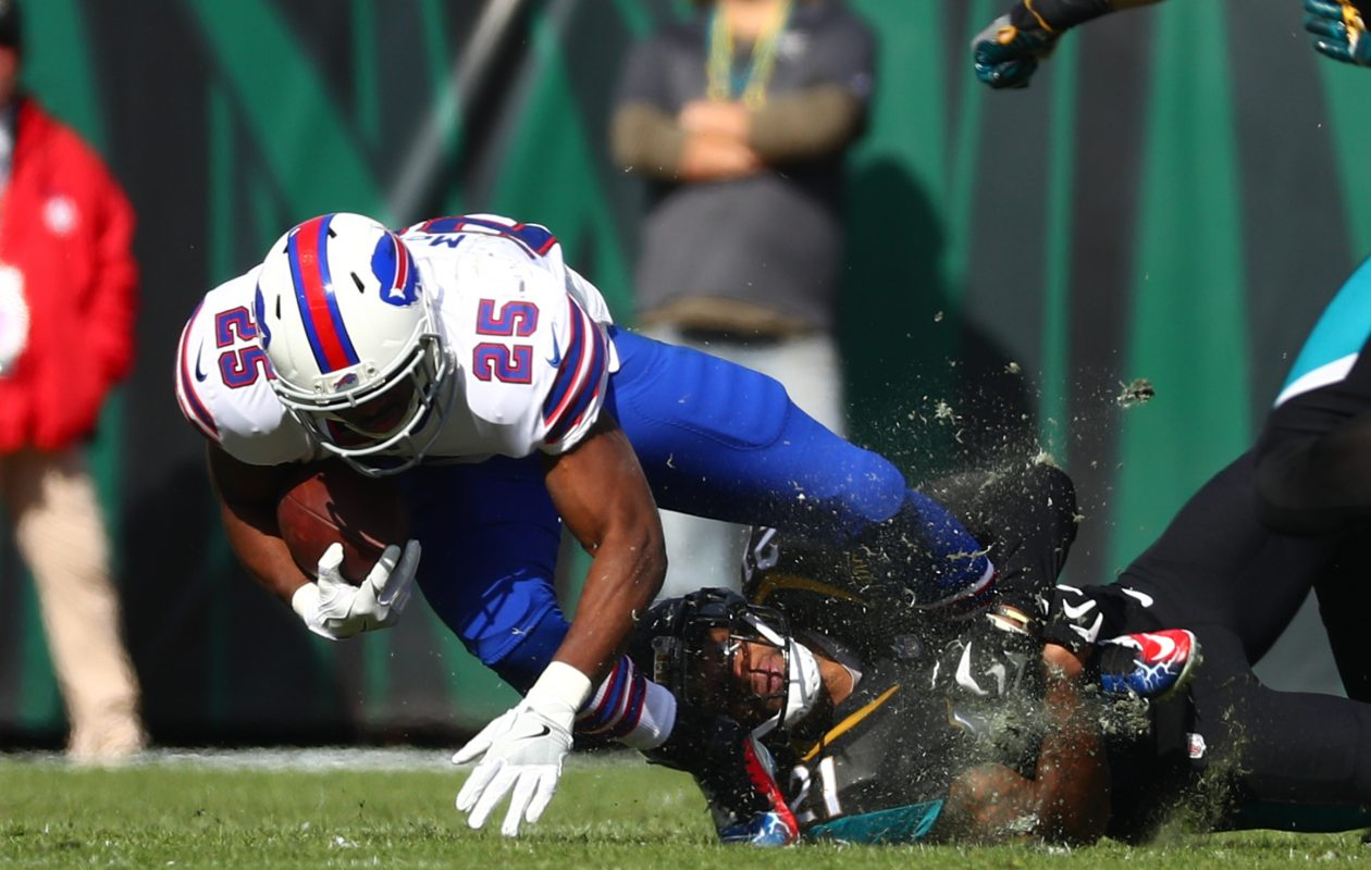 Buffalo Bills running back LeSean McCoy (25) rushes for a first down against Jacksonville Jaguars cornerback A.J. Bouye (21) in the first quarter at EverBank Field in Jacksonville, Fla., on Sunday, Jan. 7, 2018. (James P. McCoy/Buffalo News)