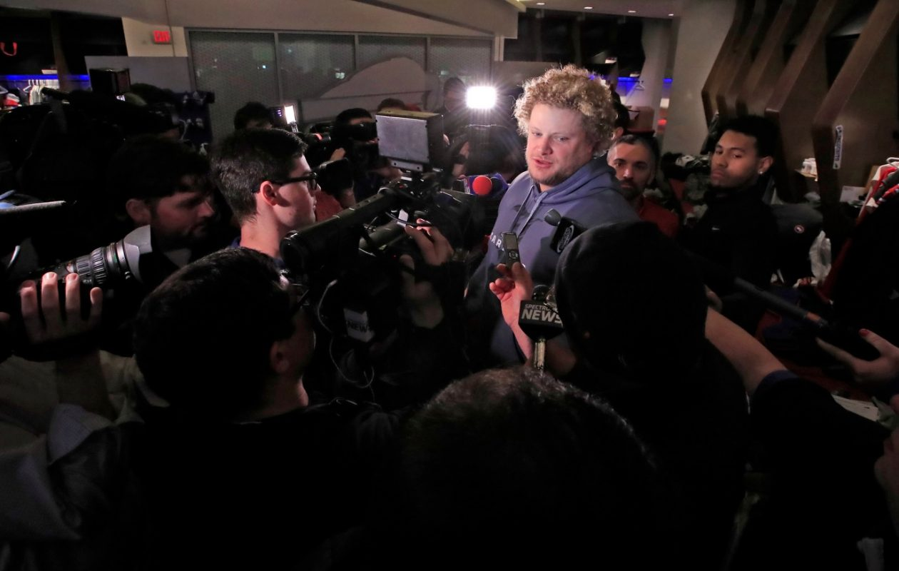 Eric Wood speaks to the media as he cleans out his locker. (Harry Scull Jr./Buffalo News)