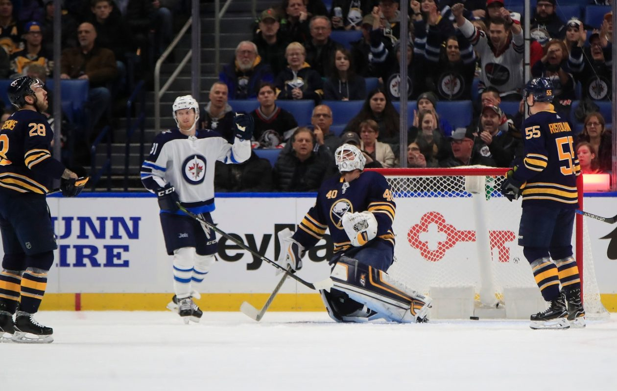 The Sabres' Zemgus Girgensons (28), Robin Lehner and Rasmus Ristolainen (55) have a sadder reaction that Winnipeg's Kyle Connor. (Harry Scull Jr./Buffalo News)