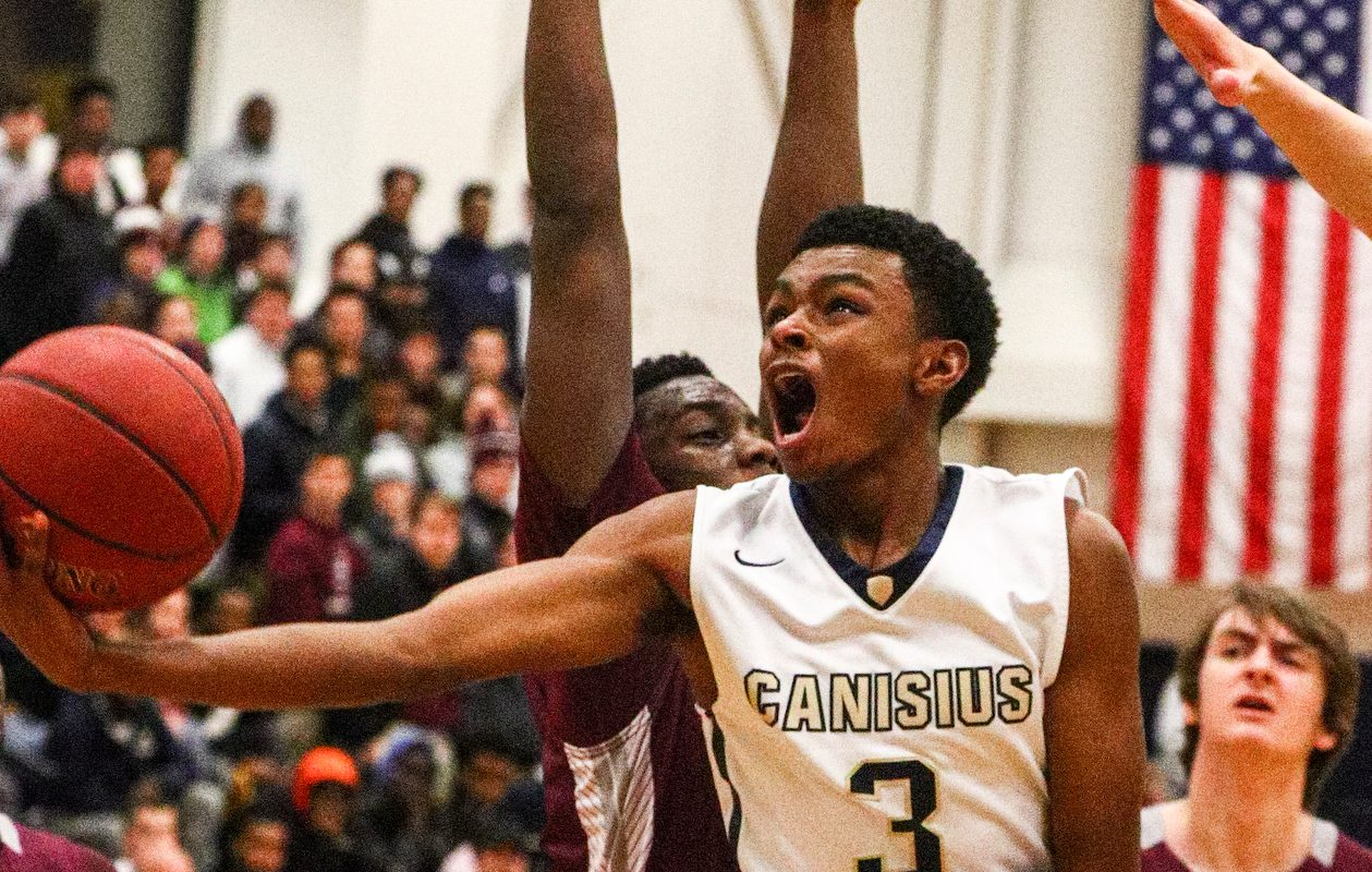 Canisius' Austin James scores two points in the Crusaders' win over St. Joe's Tuesday. (James P. McCoy/Buffalo News)