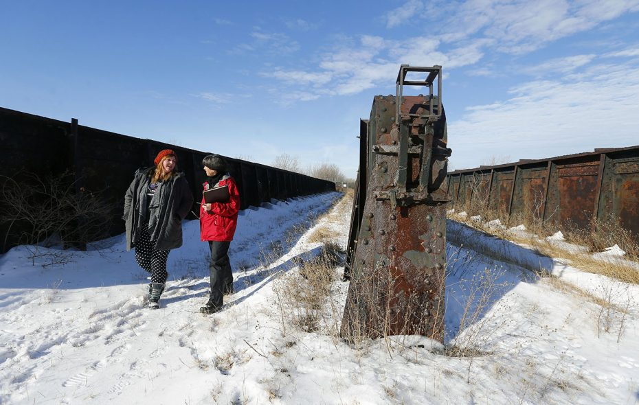 """Sara Heidinger, left, and Nancy Smith explore an old rail bed envisioned to be part of Buffalo's """"High Line."""" (Mark Mulville/Buffalo News)"""