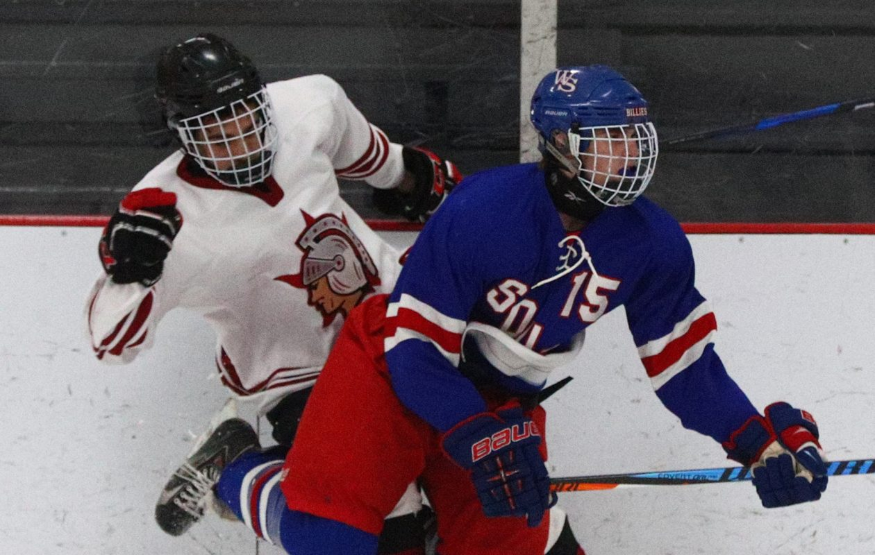 Starpoint's Josh Kelly and Williamsville South's Clayton Wehr tie up along the boards in the first period of their game at Hockey Outlet in Wheatfield. Starpoint won, 4-0. (James P. McCoy/Buffalo News)