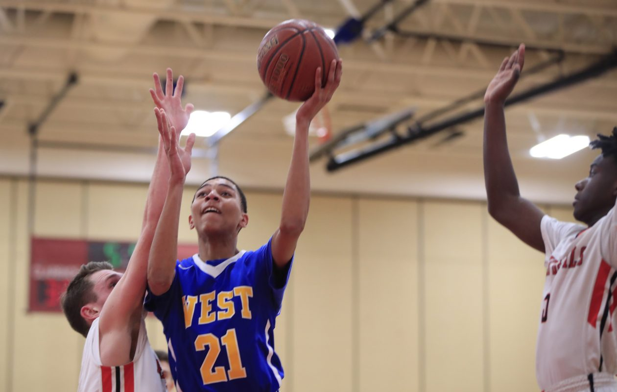 West Seneca West's Adrian Baugh drives to the basket for two of his game-high 25 points during the Indians' win at Clarence on Thursday night. (Harry Scull Jr./ Buffalo News)