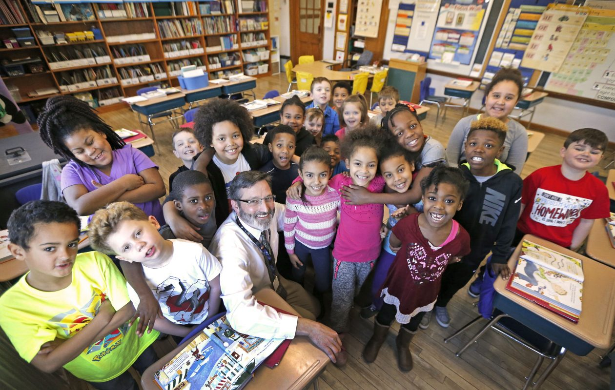 David Glahe, an innovative second-grade teacher at Hyde Park Elementary School in Niagara Falls, is surrounded by his pupils.  (Robert Kirkham/Buffalo News)