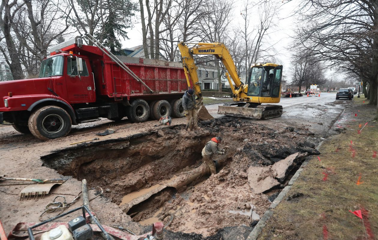 A crew from Destro & Brothers repairs a water main break on Lafayette Avenue in Buffalo just west of Gates Circle, Tuesday, Jan. 23, 2018. They estimated to be finished and open the road by about 6 p.m. (Sharon Cantillon/Buffalo News)